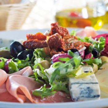 Plate of ham, cheese and olives